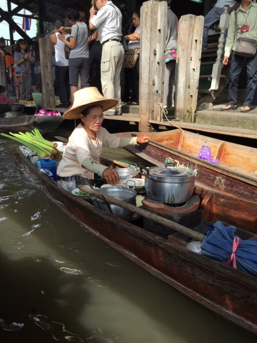 Lady cooking at the Floating Market