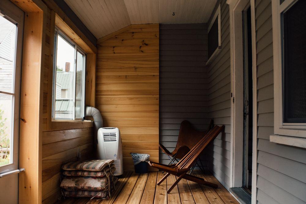 brown wooden chair near clear glass window