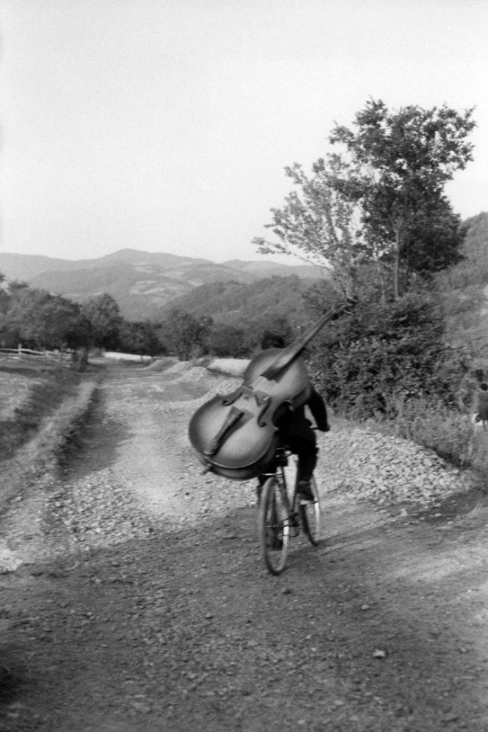 Henri Cartier-Bresson Serbia. Bass player on the road Belgrade-Kraljevo, to play at a village festival near Rudnick Yugoslavia 1965