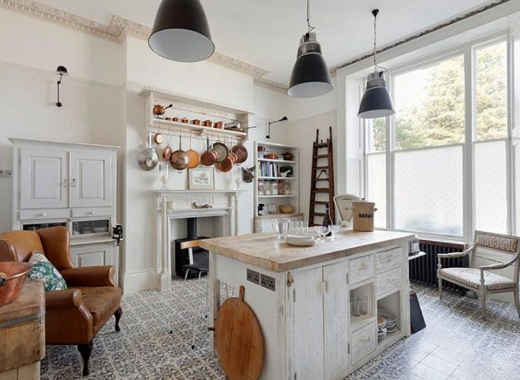 A beautiful shabby chic kitchen with ornamented tiled flooring