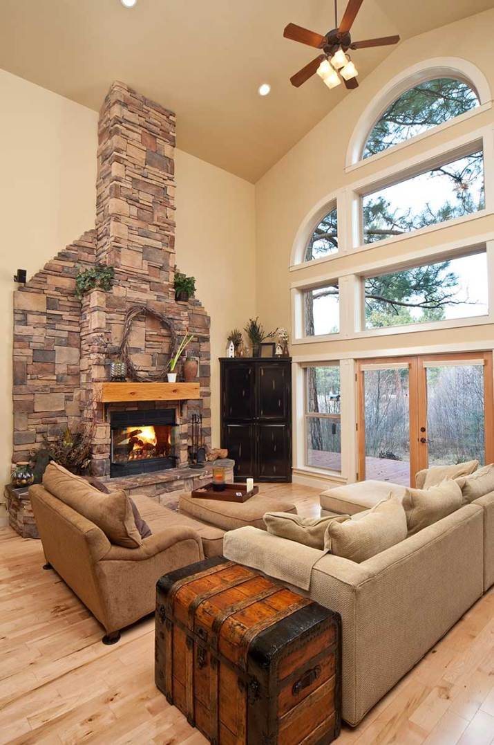 Modern-living-room-with-high-ceiling-treasure-chest-and-brick-fireplace