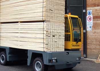 Baumann Sideloader carrying large stacks of cut lumber