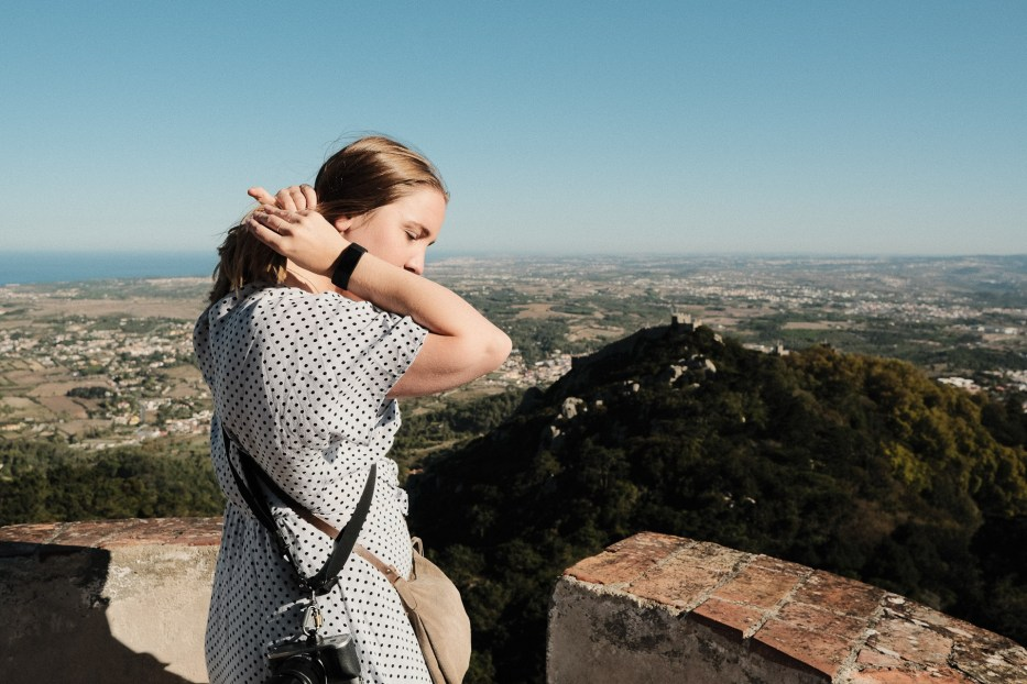 woman fixing her hair at a view point in sintra portugal