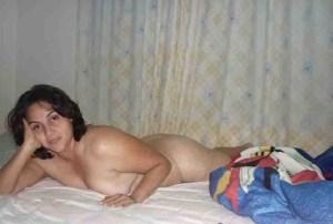 amateur desi aunty nude on bed image