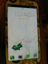 http://www.reddit.com/r/pics/comments/16kpr0/busted_phone_screen_made_the_best_of_it_xpost/