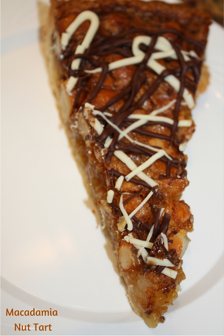 Macadamia Nut Tart is packed with nuts in every bite and has a beautiful chocolate drizzle on top. A recipe sure to please a crowd!