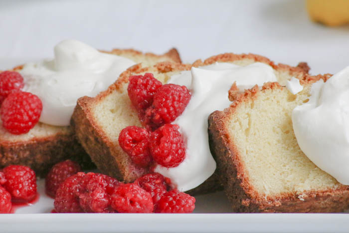 Lemon Mascarpone Pound Cake combines the elements of creamy with tangy with an added bonus of a hint of boozy in the sauce. Perfect for entertaining! #FWCon