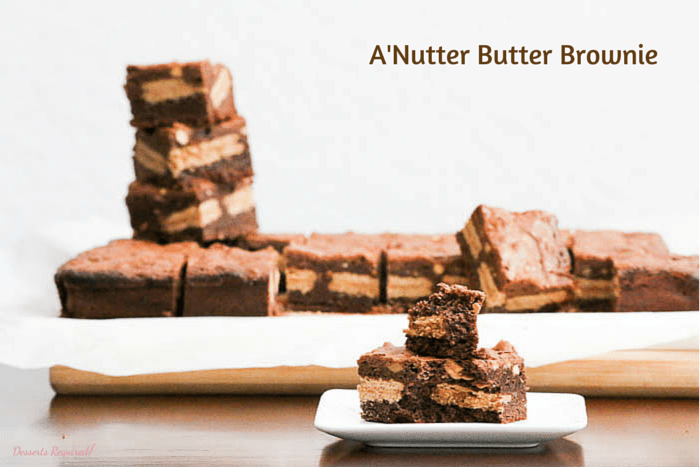 Desserts Required's A'Nutter Butter Brownie has a yummy surprise in the middle...Nutter Butter Cookies. The peanut butter mixed into the top of the chocolate batter guarantees smiles from the chocolate/peanut butter lovers in your life!