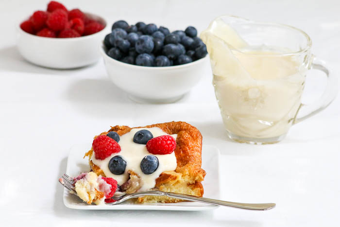 Desserts Required's Berry Brioche Bread Pudding with its raspberries and blueberries is perfect for July 4th. The raspberry liqueur sauce is a delicious and easy recipe, too.