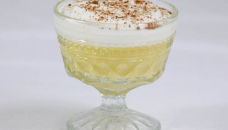 Eggnog pudding is complemented with a rum whipped cream topping and dusting of nutmeg. A must make recipe this holiday season. #SafeNog
