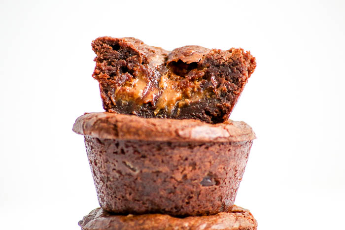 Gooey S'more Brownie Cups are outrageous. The graham cracker taste comes from Biscoff cookie butter spread. Plenty of marshmallows and chocolate, too!