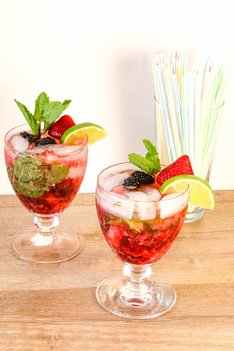 Double Berry Coconut Rum Mojito is a berry refreshing drink filled with blackberries and strawberries. Perfect for a party.