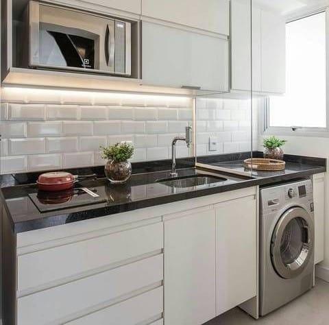 Lave-linge encastrable dans la cuisine
