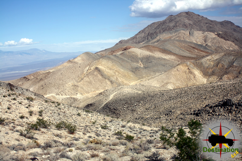 Looking down at the Lippincott Mine Road from the Lippincott Mine, with Saline Valley in the distance.