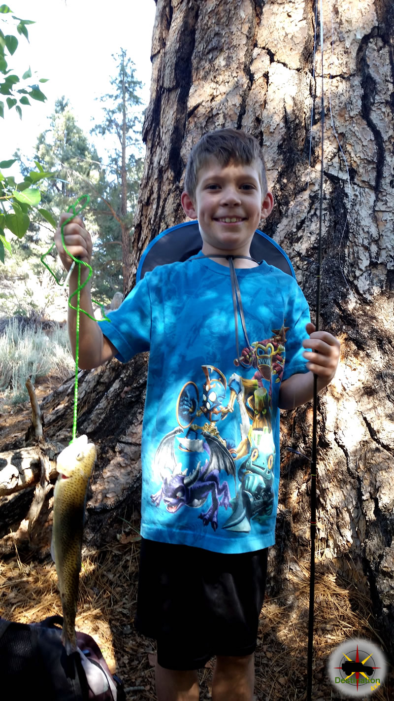 His first Rainbow Trout caught in under five minutes proves my superior fishing technique.