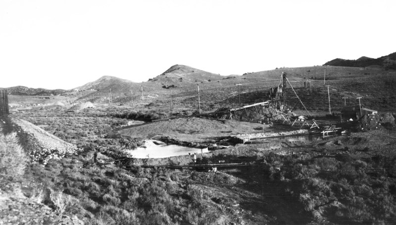 Placer mine in western part of Manhattan Gulch, showing sluice boxes and pond. Nye County, Nevada. 1915. Plate 17-B in U.S. Geological Survey. Bulletin 723. 1924.