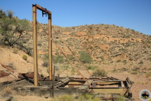 A metal headframe marks a vertical shaft in the mining district outside of Vanderbilt California.