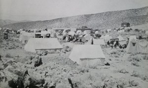 Tents and autos parked along side during during the goldrush of 1927 - Leonard Trayner Collection - Paher