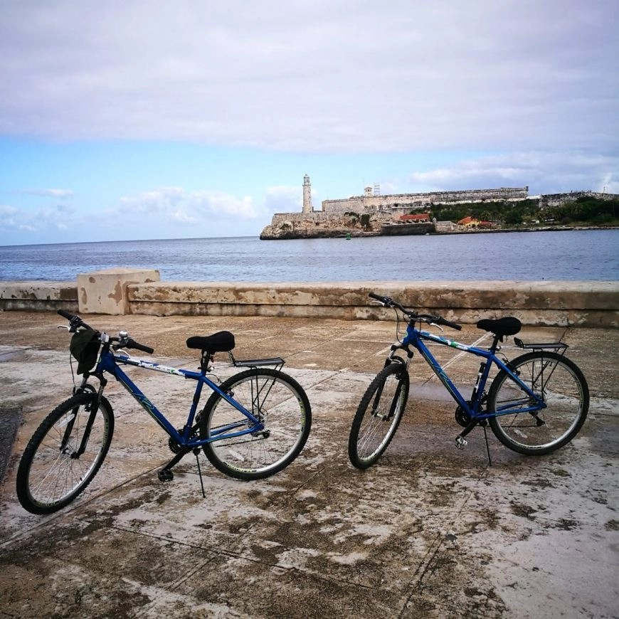 Our bikes parked up whilst we take a break on the Malecón, Havana