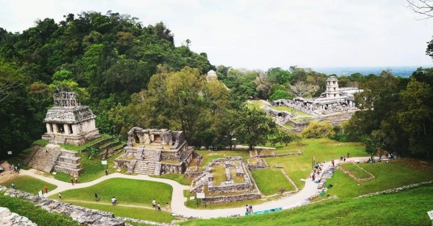 Destination Addict - A view up high of the ruins of Palenque, Mexico