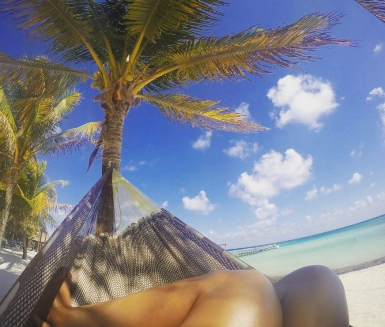 Destination Addict - Relaxing in a hammock on the beach in Mahahual