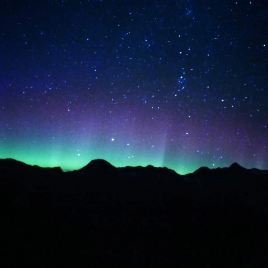 Destination Addict - The northern lights dancing in the sky, Russet Lake, near Whistler, British Columbia, Canada