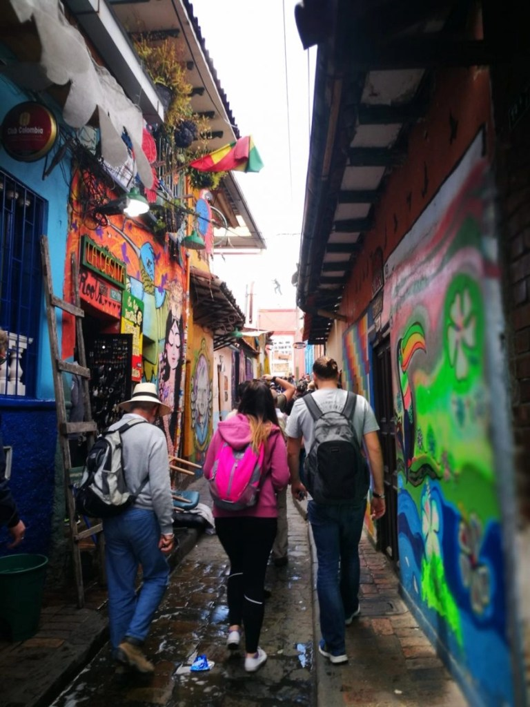 Walking through the old, cobbled, street art filled streets of La Candelaria - Bogota Tours