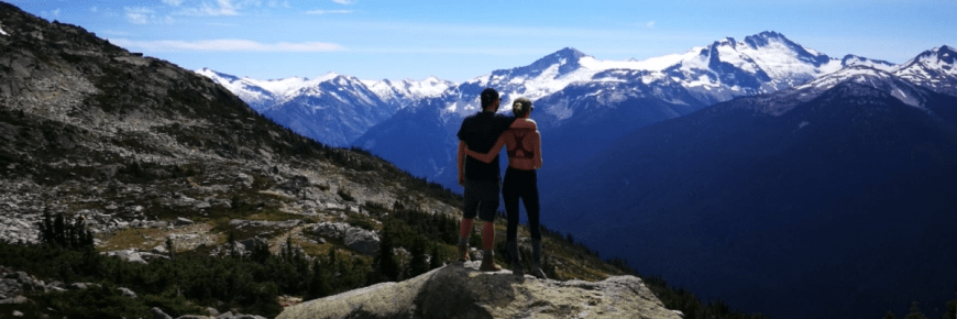 Travel & adventure couple - Destination Addict - Taking in the views on the Musical Bumps Trail, near Whistler, British Columbia, Canada