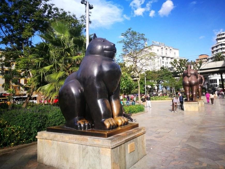 Destination Addict - El Gato y El Caballo statues by Fernando Botero, Parque Botero, Medellin, Colombia