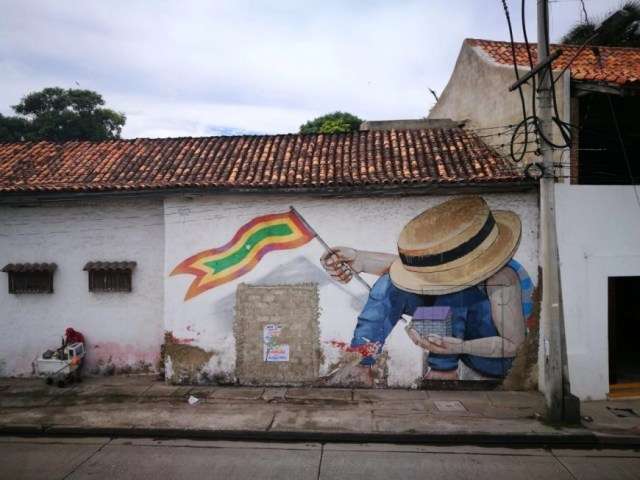 Destination Addict - Taking in some street art from the city walls, Cartagena, Colombia