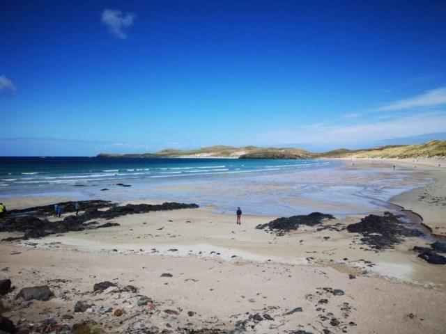Walking along the gorgeous Balnakeil Beach -  NC500 – An Epic Itinerary For Scotland's North Coast - Destination Addict