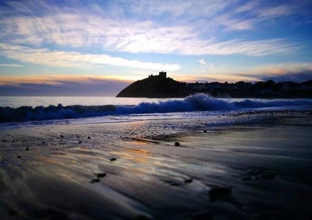 Watching the sun go down when visiting Criccieth, Wales, UK