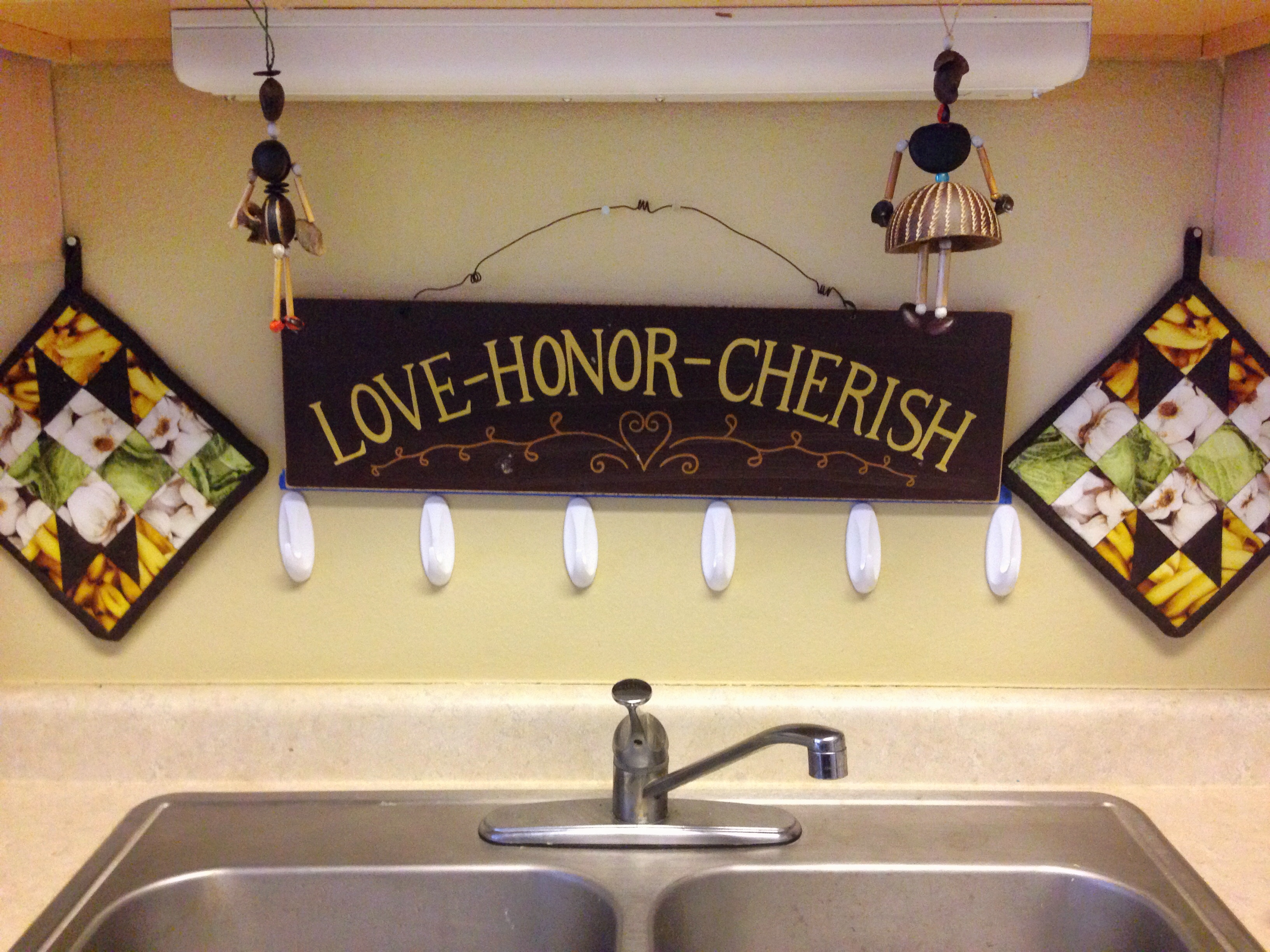 Organize Your Kitchen Cabinets With A DIY Mug Hanger   Use 3 M Command Hooks