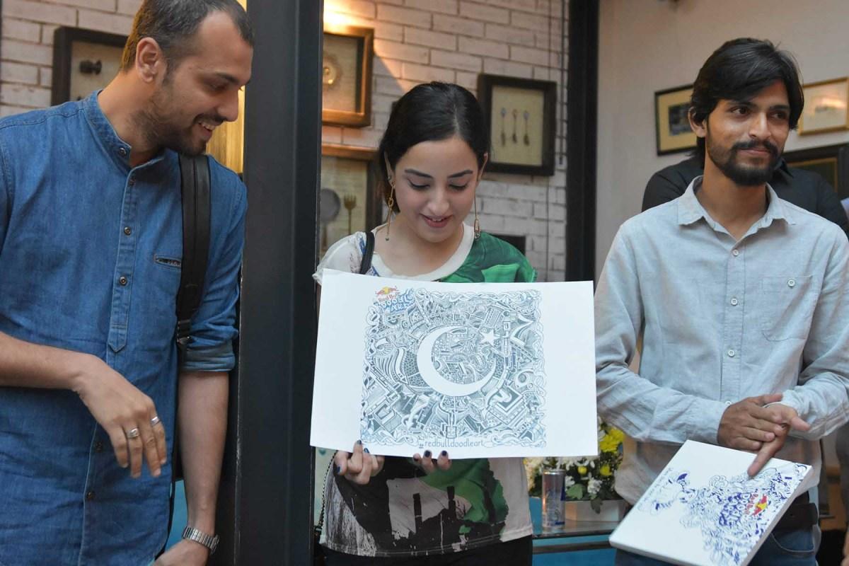 Saad, Samya and SM Raza presenting Umer Nadeem's winning doodle