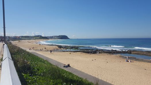 Merewether Beach Looking at Bar Beach with a sandy beach and ocean waves