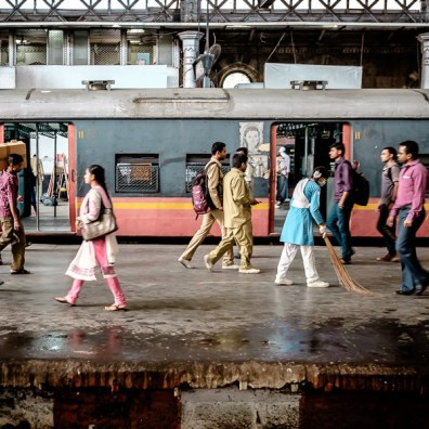 Volunteers cleaning the platform every time a train arrives at Mumbai CST.