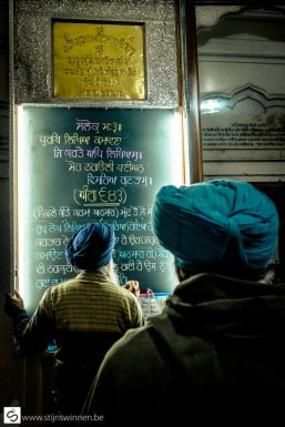 Sikh writing excerpt from prayer on chalkboard