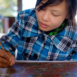 Pretty Myanmar girl painting
