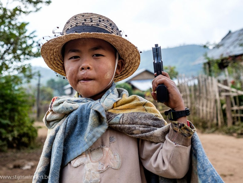Little gangster boy showing his toy gun