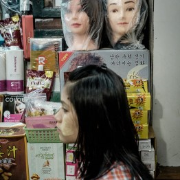 Plastic bags over white coloured mannequin head for protection