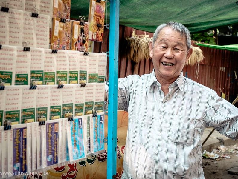 Man selling lottery tickets in Yangon