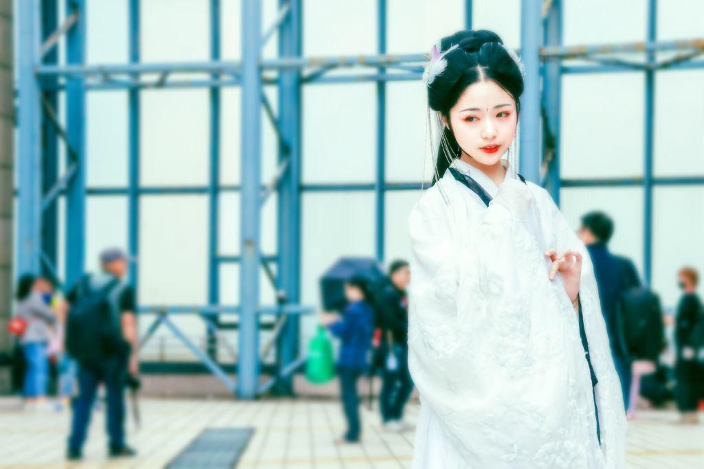 Vestes tradicionais chinesas Mulher chinesa com roupas brancas e penteado típico