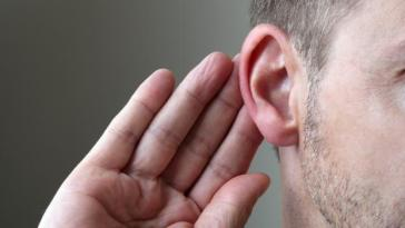 bigstock-close-up-on-hand-and-ear-liste-23189027