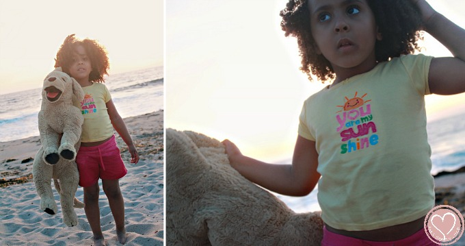 biracial girl at the beach in california