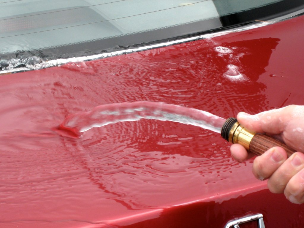Rinsing a car after washing