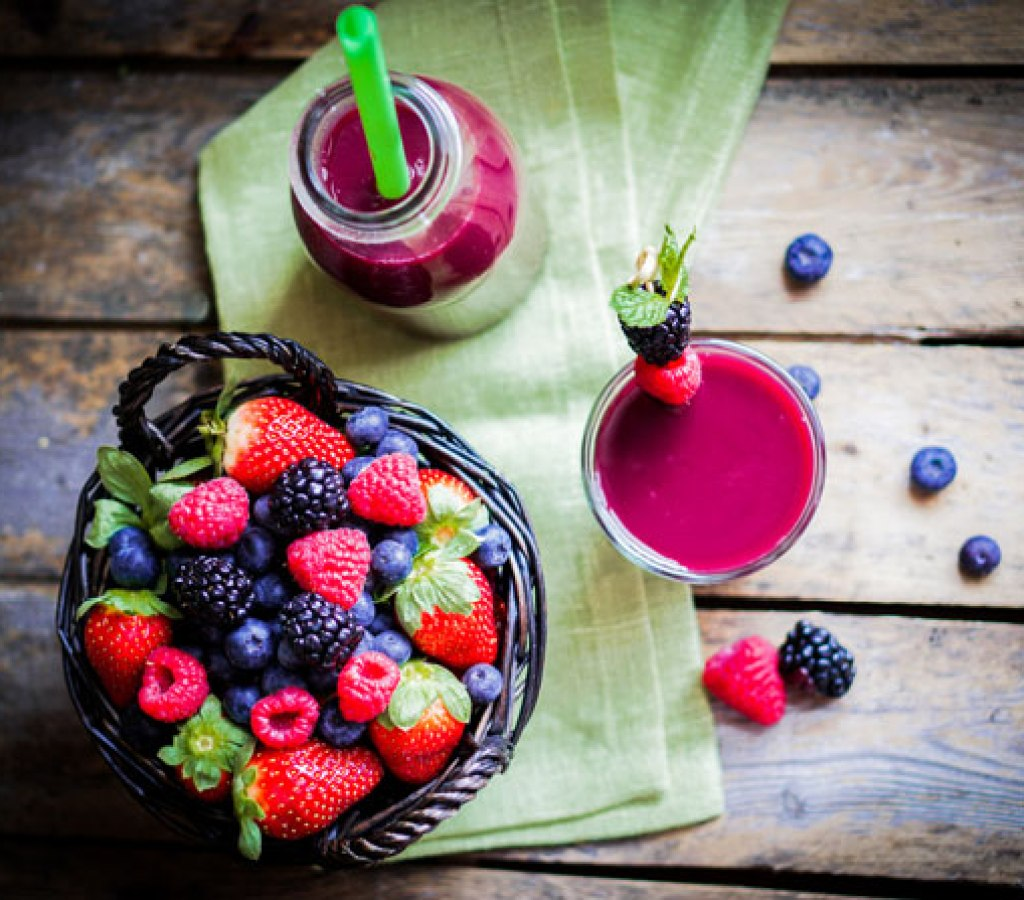 Berry-smoothie-on-rustic-wooden-background