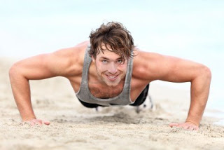 11841078-fitness-man-exercising-push-ups-smiling-happy-male-fitness-model-cross-training-on-beach-caucasian-m