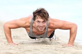 11841078-fitness-man-exercising-push-ups-smiling-happy-male-fitness-model-cross-training-on-beach-caucasian-m