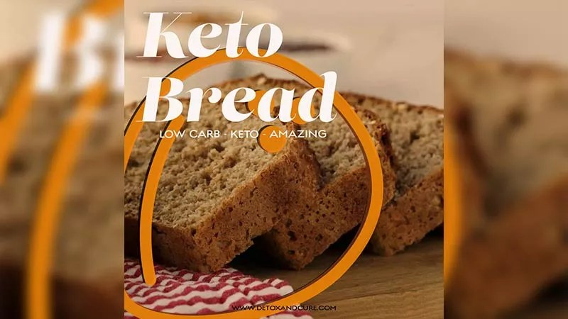"Perfect Ketosis Bread Recipe to keep you On Track. Slices of keto friendly bread diagonally laid upon each other on a timber chopping board with a red and white striped cloth to the left of them. This image is overlaid with the text ""keto bread, low carb, keto, amazing' with a coconut icon to the left of the image."