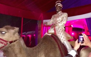 Adrian Peterson rides a camel at his birthday party. (Instagram)